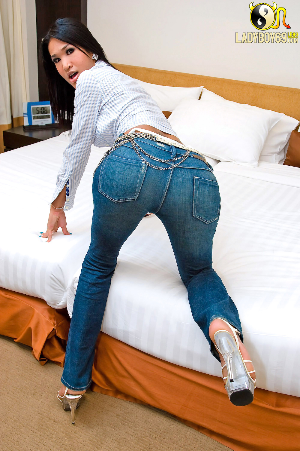 Sexy woman wearing boots and tight jeans