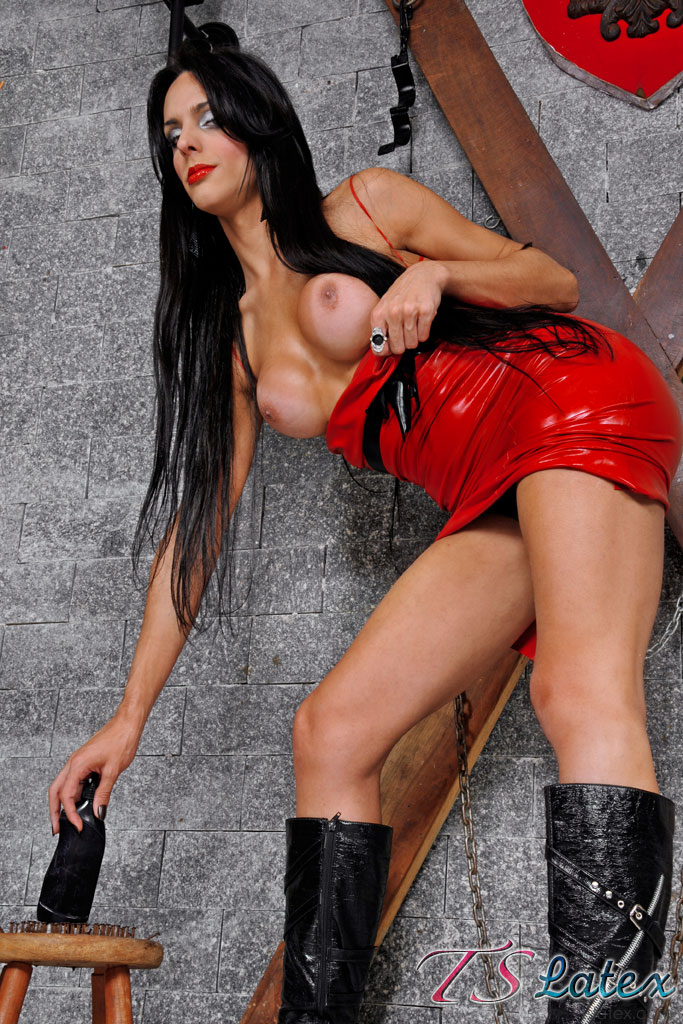 image Hot tbabe in red fishnet overall strokes cock while smoking