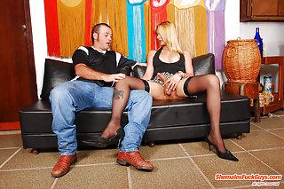 Alluring blonde tranny clad in stockings fucks dude