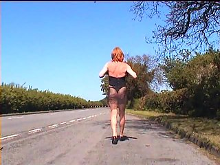 Ladyboy In Lingerie  Walks Outdoors