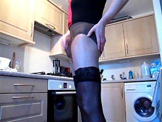 Amateur crossdresser solo in a kitchen
