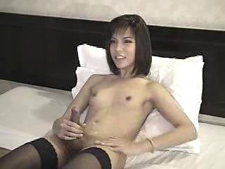 Small tits tgirl enjoys dick stroking