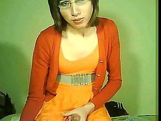 Lonely tranny in orange jerks for webcam