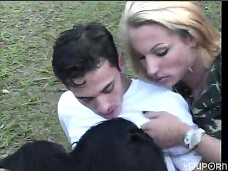 Blond and brunette shemale in outdoor trio