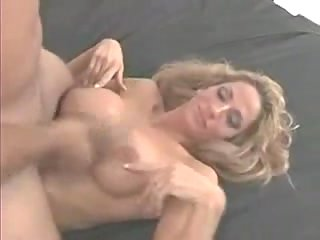 Busty tranny gives skilful blowjob