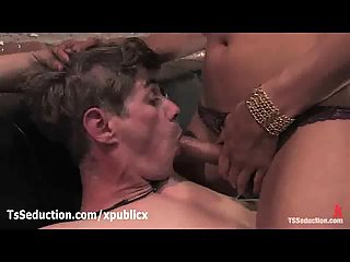 Brunette tranny fucks handcuffed guy in mouth