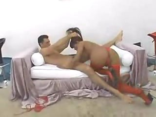 Dude fucks a shemale in red stockings