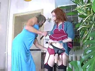 Maid pleases a TS with a strap-on