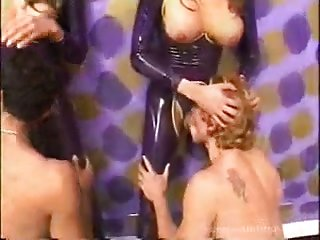 Mad Latex ladyboys giving their prick in turn