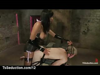 Bound guy mouth and ass screwed by tranny