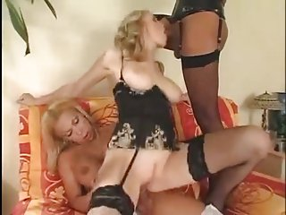Dirty slut serving two TS cocks