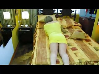Crossdresser in yellow eats two cocks in turn