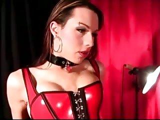 TS in latex corset gets blowjob
