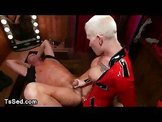 Busty blonde tranny in latex fucks guy