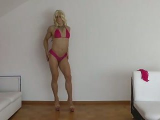 Dancing crossdresser shows off her ass