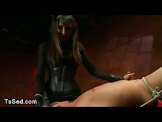 Bound guy fucked by big cock tranny in leather skirt