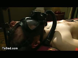 Bound guy with locked dick by tranny in latex dress