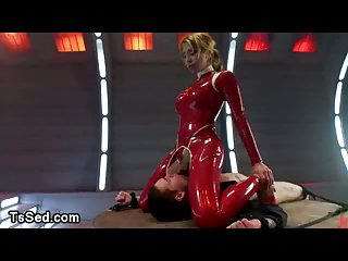 Bound bloke fucked in his mouth by tranny in latex