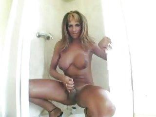 Busty sexy tranny jerking off