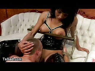 Busty tranny in latex fucks in mouth and ass tied guy