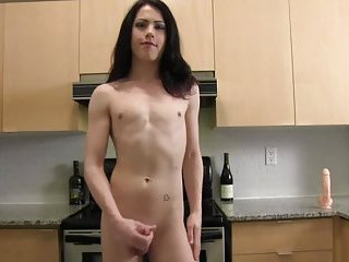 Hung Cutie plays in a kitchen