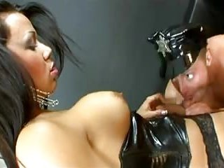 Domination act with a dirty tranny in latex