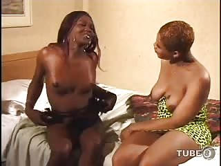 Two ebony shemales drill each other with big cocks