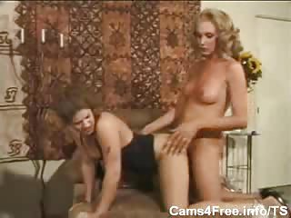 Horny blonde tranny fucks babe on the couch