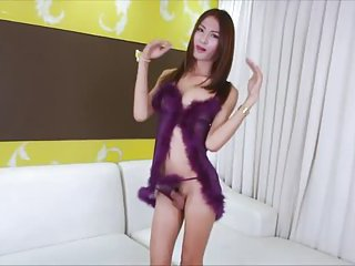 Alluring asian shemale Toon plays her cock