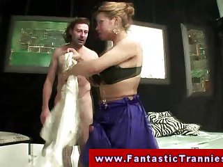 Wild tranny dominates a naked guy