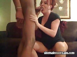 Redhead tranny sucks black cock