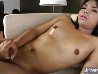 Seductive Thai ladyboy Eve G masturbates