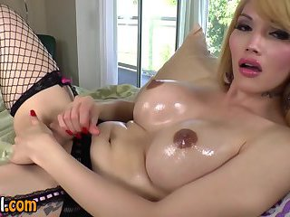 Busty solo tranny jerks her cock