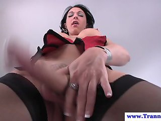 Shemale in stockings loves the feeling of sticky cum on her stomach