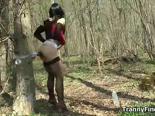 Crossdresser in a forest