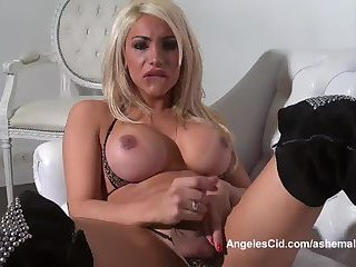 Busty Blonde Tranny Jerks Her Huge Cock On The Couch
