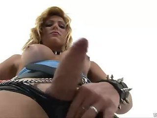 Blonde tranny wearing latex gets fucked hard