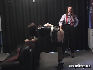 Mistress gives her sexy latex crossdresser pantie maid a good ass spanking and boob sucking