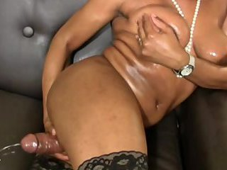 Big ass ebony tranny plays with monster cock and cumshots