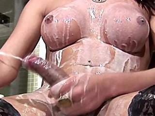 Tgirl soaks her bigtits in milk and shoots one big jizzload