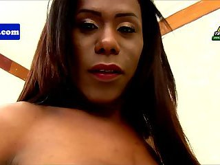 Busty brazilian tgirl tugs cock