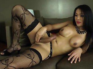 Ladyboy Fanta in lingerie masturbating