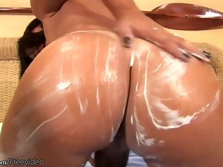 Big boobed t-girl spreads lotion on her fine tanned body