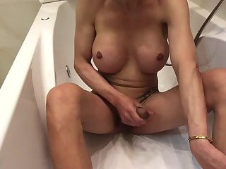 Solo busty TS jerks off in the bathroom