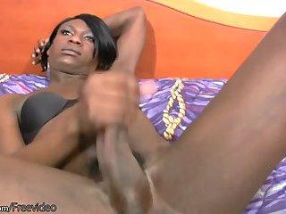 Long haired ebony tranny teases the camera and sucks cock