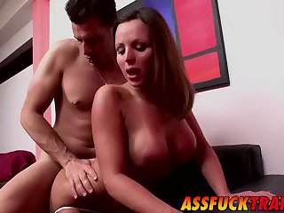 Horny dude Axel Ray drills super hot transsexual on a sofa