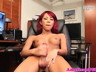 Gorgeous tgirl pleasures herself in office