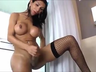 Busty Tranny Shows Giant Cock