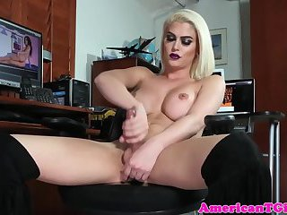 Bigtitted tgirl strokes her cock in office