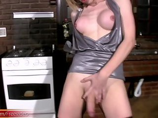 Busty blonde shemale masturbates girly shecock in high boots